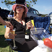 'A Day at the Polo'<br /> A strawberry is added to a glass of champagne as spectators  entertain themselves during the International Polo Test match between Australia and England at the Windsor Polo Club, Richmond, Sydney, Australia on March 29, 2009. Australia won the match 8-7.  Photo Tim Clayton