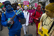 Demonstrators painted different colours and playing music at Anti-racism Day demonstration led by Stand Up To Racism on 19th March 2016 in London, United Kingdom. Stand Up To Racism has led some of the biggest anti-racist mobilisations in Britain of the last decade, making a stand protesting against racism, Islamophobia, anti-Semitism and fascism.