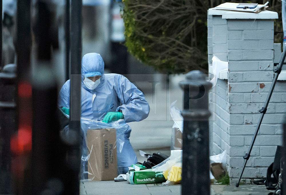 © Licensed to London News Pictures. 16/03/2019. London, UK. Police forensics bagging evidence at the scene where a 29 year old man has been stabbed to death on Gowan Avenue in Fulham, West London. Photo credit: Ben Cawthra/LNP