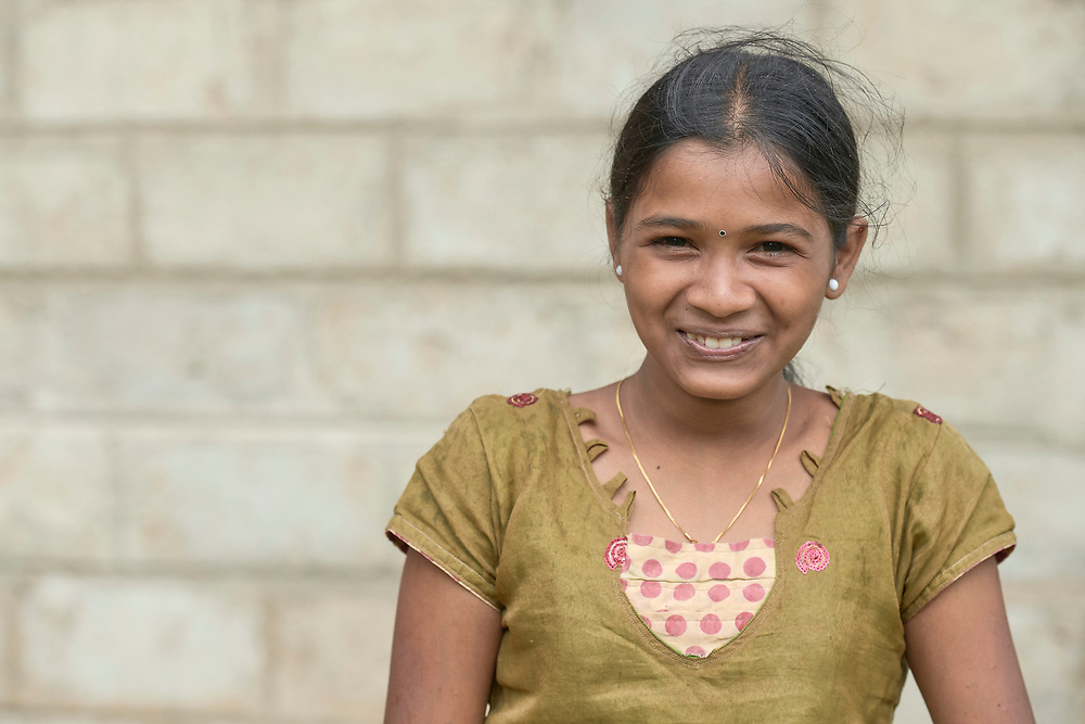 A girl in Parantan, Kilinochchi, Sri Lanka. Her mother participates in a church-sponsored women's group, many of whose members are widows, their husbands killed during the country's brutal civil war.