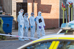 © Licensed to London News Pictures. 22/04/2021. Walton-on-Thames, UK. Forensic investigators examine the scene behind a row of shops. Police responded to an incident at 14:15 BST on Church Street in Walton-on-Thames, police and forensic investigators could be seen at the scene. Photo credit: Peter Manning/LNP