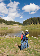 Two hikers on hike in mountains of New Mexico.