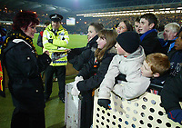 30/11/2004 - Watford v Portsmouth - Carling Cup - Quarter Final<br />Sharon Osbourne signs autographs for the young Watford fans at halftime for their match against Portsmouth.<br />Jed Leicester/Back Page Images