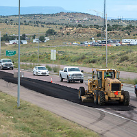 A crew from New Mexico Department of Transportation continues road maintenance on Highway 491 by laying down new asphalt Wednesday.