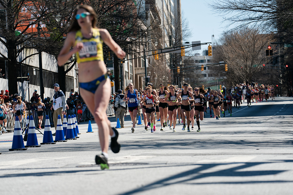 The field of women come down Marietta Street on the first loop during the 2020 U.S. Olympic marathon trials in Atlanta on Saturday, Feb. 20, 2020. Photo by Kevin D. Liles for The New York Times