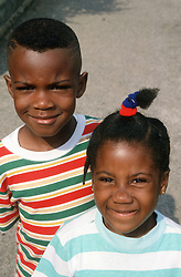 Portrait of young brother and sister smiling,