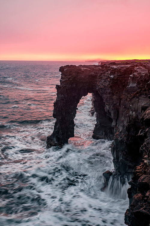 The Holei Sea Arch, photographed suring an incredible pink sunset that turned the world an amazing shade of pink.
