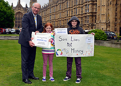 © Licensed to London News Pictures. 14/05/2013. Westminster, UK Nick Harvey MP, Alicia Thelwell, Josh Thelwell. Patients campaigning for a life-saving treatment to be made available for all sufferers of the rare blood disease atypical Haemolytic Uraemic Syndrome (aHUS) present an urgent petition with over 30,000 signatures to MPs at the House of Commons on Tuesday May 14 2013... Photo credit : Stephen Simpson/LNP