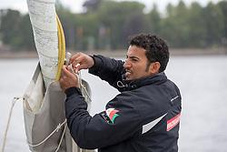 Yassir Al Rahbi (OMA). Oman Sail's MOD70 Musandam races in the Eckernförde race at  Kiel week 2014, 21-06-2014, Kiel - Germany.