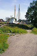 Cargo ship passing through lock gates on inland waterway, Sweden 1970