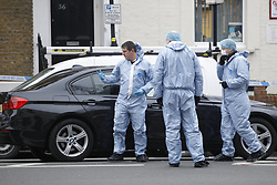 © Licensed to London News Pictures. 21/02/2018. London, UK. Police forensics officers work in Malden Road, Camden, where one of two stabbings took place yesterday evening, killing two young men. Police were called to a second disturbance in the area, in which a second man was stabbed to death, and are currently investigating if the two incidents are connected. Photo credit: Peter Macdiarmid/LNP