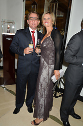 DEREK & COLLEEN BRUGMAN at the Longines World's Best Racehorse Awards 2014 hosted by Longines and the International Federation of Horseracing Authorities held at Claridge's, Brook Street, London on 20th January 2015.