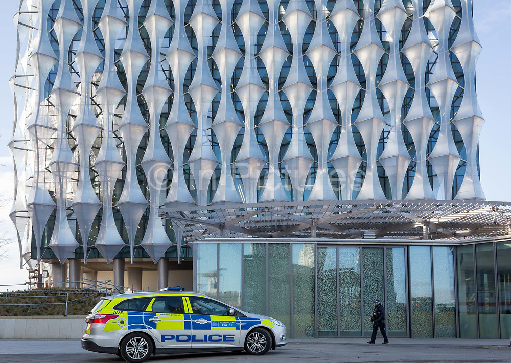 An armed police presence outside the US Embassy at Nine Elms in south London, on 16th January 2018, in London, England. On the day when the consulate opened for public business visa applications etc., after its controversial move from Grosvenor Square in central London to the south bank and which President Trump has refused to officially open.