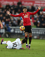 Borja Baston of Swansea city is fouled by Marcos Rojo of Manchester Utd (r) ..Premier league match, Swansea city v Manchester Utd at the Liberty Stadium in Swansea, South Wales on Sunday 6th November 2016.<br /> pic by  Andrew Orchard, Andrew Orchard sports photography.