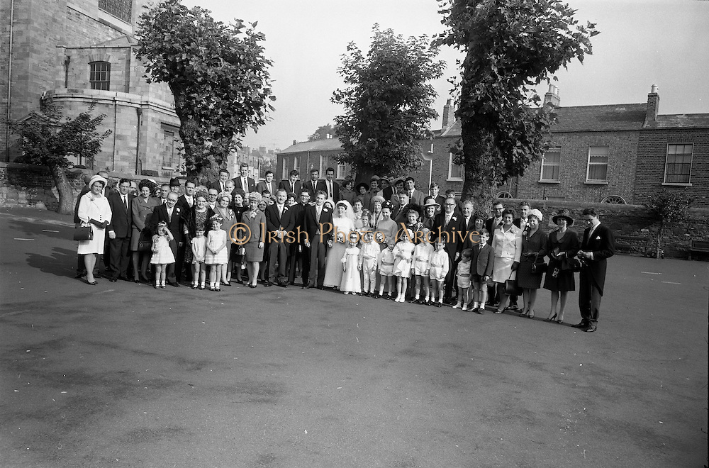 """16/09/1967<br /> 09/16/1967<br /> 16 September 1967<br /> Wedding of Mr Francis W. Moloney, 28 The Stiles Road, Clontarf and Ms Antoinette O'Carroll, """"Melrose"""", Leinster Road, Rathmines at Our Lady of Refuge Church, Rathmines, with reception in Colamore Hotel, Coliemore Road, Dalkey. Image shows the whole attendance at the wedding outside the church after the ceremony."""