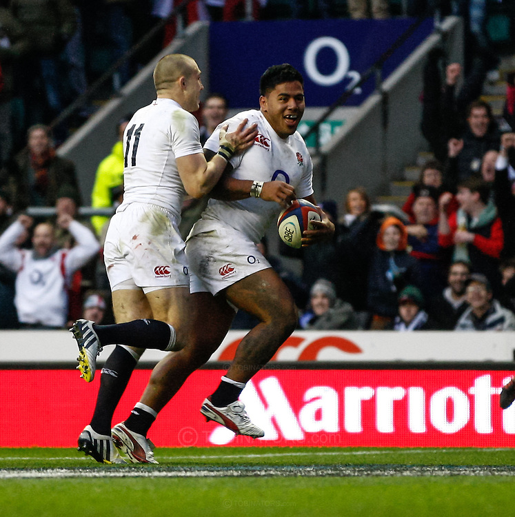 Picture by Andrew Tobin/SLIK images +44 7710 761829. 2nd December 2012. Manu Tuilagi of England runs in his try with Mike Brown (L) during the QBE Internationals match between England and the New Zealand All Blacks at Twickenham Stadium, London, England. England won the game 38-21.