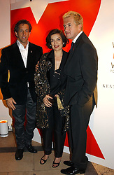 A party hosted by Mario Testino, Bianca Jagger and Kenneth Cole in collaboration with UNFPA and Marie Stopes International to celebrate the publication of Women to Woman: Positively Speaking - a book to raise awareness of women living with HIV/Aids, held at The Orangery, Kensington Palace, London on 2nd December 2004.<br />Picture shows:- Left to right, designer KENNETH COLE, BIANCA JAGGER and photographer MARIO TESTINO.<br /><br />NON EXCLUSIVE - WORLD RIGHTS