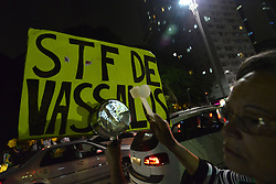 April 25, 2018 - Sao Paulo, Brazil - Protesters protest against STF on Avenida Paulista, in Sao Paulo, Brazil, on 25 April 2018. Federal Supreme Court (STF) that removed from federal judge Sérgio Moro excerpts from Odebrecht's disclosure opens a strong breach for the defense of former president Luiz Inacio Lula da Silva (PT) to annul the conviction in the case of the triplex in Guarujá, say experts heard by the Broadcast Político, real-time news service of Grupo Estado.....Demonstrators burned on Paulista Avenue in front of the court of justice a doll representing Federal Supreme Court (STF) ministers who withdrew from federal court judge Sérgio Moro excerpts from Odebrecht's indictment. (Credit Image: © Cris Faga/NurPhoto via ZUMA Press)