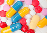 an assortment of pills and capsules on white background