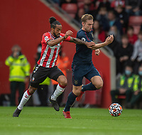 Burnley's Charlie Taylor (right) under pressure from Southampton's Theo Walcott (left) <br /> <br /> Photographer David Horton/CameraSport<br /> <br /> The Premier League - Southampton v Burnley - Saturday 23rd October 2021 - St Mary's Stadium - Southampton<br /> <br /> World Copyright © 2020 CameraSport. All rights reserved. 43 Linden Ave. Countesthorpe. Leicester. England. LE8 5PG - Tel: +44 (0) 116 277 4147 - admin@camerasport.com - www.camerasport.com