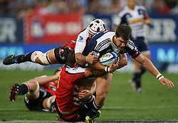 Danie Poolman is tackled during the Super Rugby (Super 15) fixture between the DHL Stormers and the Lions held at DHL Newlands Stadium in Cape Town, South Africa on 26 February 2011. Photo by Jacques Rossouw/SPORTZPICS