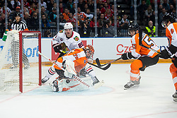 Brandon Saad of Chicago Blackhawks  and Carter Hart of Philadelphia Flyers  with Shayne Gostisbehere of Philadelphia Flyers  during NHL game between teams Chicago Blackhawks and Philadelphia Flyers at NHL Global Series in Prague, O2 arena on 4th of October 2019, Prague, Czech Republic. Photo by Grega Valancic / Sportida