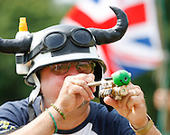 Photo by Andrew Tobin/Tobinators Ltd - 07710 761829 - Ian Ashmead shoots his hi tech laser sighted pea shooter during the World Peashooting Championships held at Witcham, Cambridgeshire, UK on 13th July 2013. Run in conjunction with the village fair, the Championships have been held in Witcham since 1971 when they were started by a Mr Tyson, the village schoolmaster, in order to raise funds for the village hall.Competitors come from as far afield as the USA and New Zealand to attempt to win the event. The latest technology is often used, including laser sights and titanium and carbon fibre peashooters. All peashooters must conform to strict length rules, not exceeding 12 inches, and have to hit a target 12 feet away. Shooting 5 peas at a plasticine target attached to a hay bale, the highest scorers move through the initial rounds to a knockout competition, followed by a sudden death 10-pea shootout.