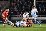 Sale Sharks flanker Ben Curry tackles Saracens No.8 Andy Christie during a Premiership Rugby Cup Semi Final won by Sale 28-7: Friday, Feb. 7, 2020, in Eccles, United Kingdom. (Steve Flynn/Image of Sport)