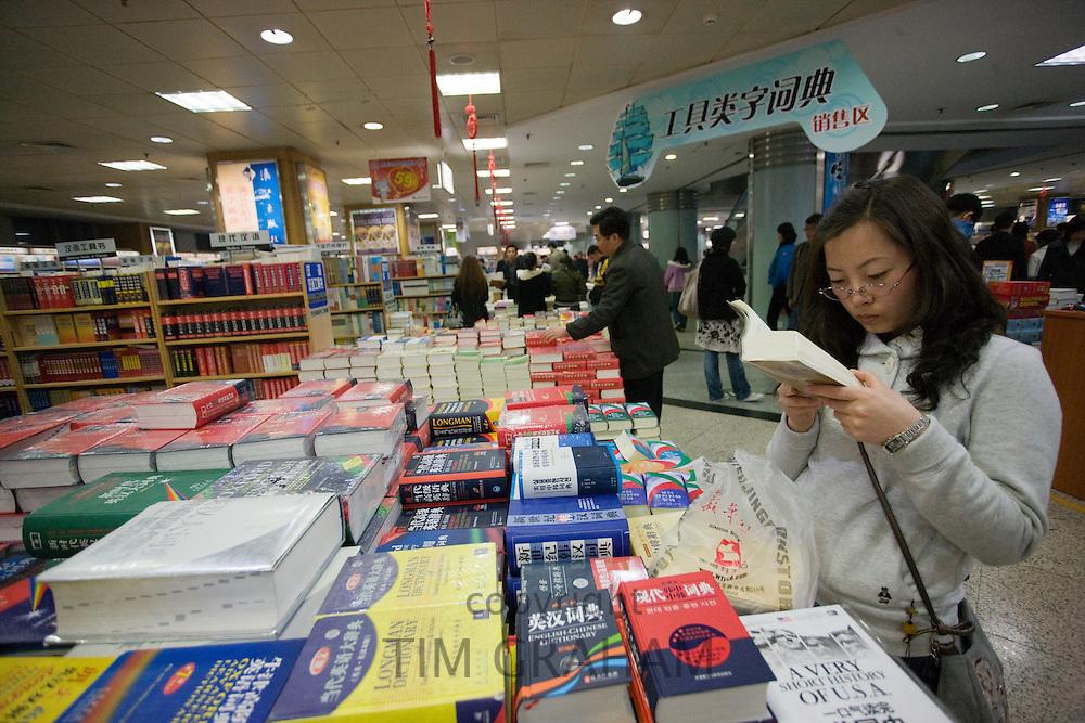 Shopper in Beijing book shop, China