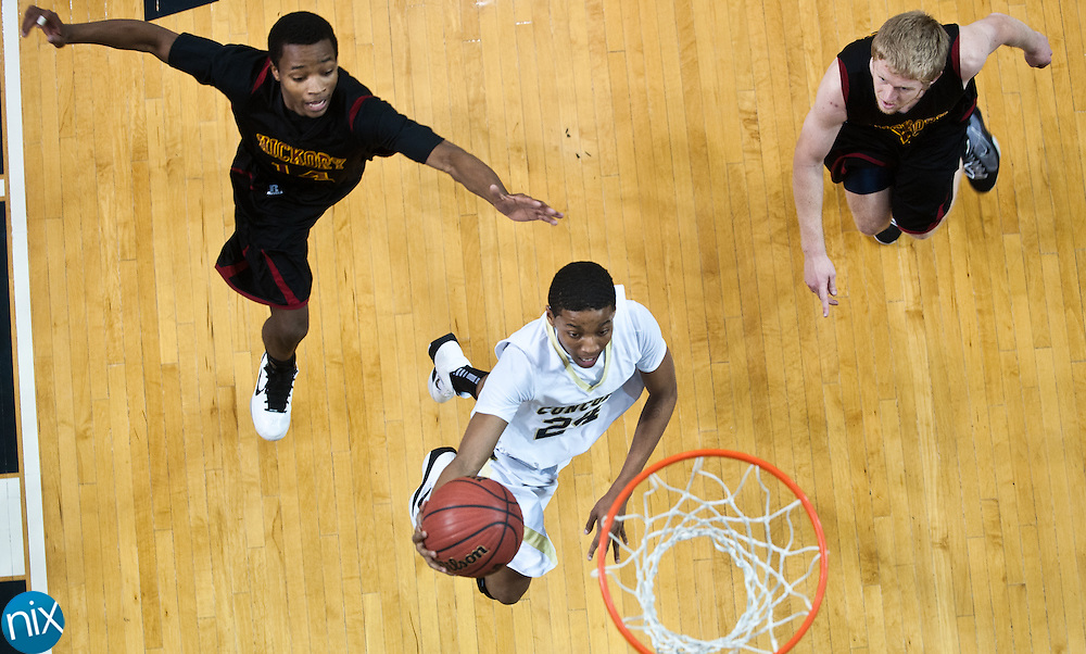 Concord's Darren Black goes up for a shot against Hickory during the regional round of the NCHSAA 3A playoffs Thursday night at the University of North Carolina at Greensboro. Hickory won the game 95-82 to end the Spiders season. (Photo by James Nix)
