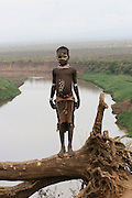Africa, Ethiopia, Omo Valley, Karo tribe, child. the Omo river in the background