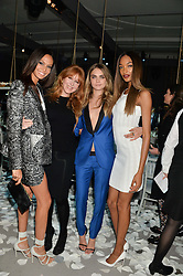 Left to right, JOAN SMALLS, CHARLOTTE TILBURY, CARA DELEVINGNE and JOURDAN DUNN at a Dinner to celebrate the launch of the Mulberry Cara Delevingne Collection held at Claridge's, Brook Street, London on 16th February 2014.