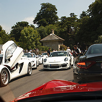 Cars gather at starting area before the hillclimb at the Goodwood Festival of Speed 2013