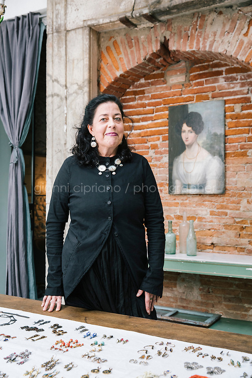 LUCCA, ITALY - 25 OCTOBER 2018: Annette Klein, an art historian and collector of antique earrings, poses for a portrait in her home  in Lucca, Italy, on October 25th 2018.<br /> <br /> Annette Klein, who grew up near Cologne in Germany, graduated with a PhD in the History of Theatre. She is an Art Historian, a collector and researcher of antique earrings. Her current research focuses on antique earrings from the 17th and 18th centuries and their geographical, historical, social and cultural context.