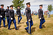 29 AUGUST 2020 - RUNNELLS, IOWA: The Iowa Army National Guard Honor Guard leaves the funeral for Pvt. Roy Brown Jr. in Runnells, IA. Pvt. Brown was a US Army soldier in World War II. He was an infantryman in the 126th Infantry Regiment, 32nd Infantry Division, serving in the Australian Territory of Papua (now Papua New Guinea). He went missing in action on Dec. 2, 1942. Unidentified remains were recovered on Feb. 2, 1943 and were eventually interred in the Manila American Cemetery. On May 14, 2019, Defense POW/MIA Accounting Agency using dental records, circumstantial evidence and DNA identified the remains as Pvt. Brown's. He was reinterred in the Lowman Cemetery in Runnells Saturday.      PHOTO BY JACK KURTZ