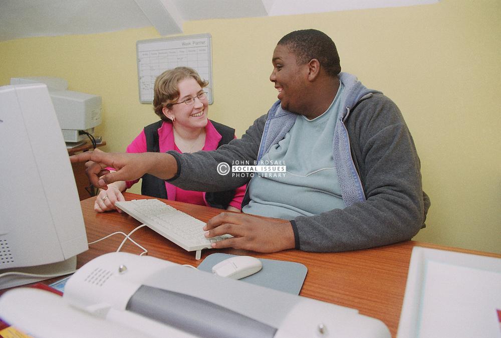 IT trainer teaching client basic computer skills,