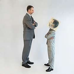 Businessman and boy wearing mask standing face to face