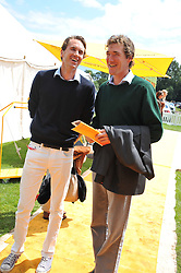 Left to right, OTIS FERRY and LUKE TOMLINSON at the 2012 Veuve Clicquot Gold Cup Final at Cowdray Park, Midhurst, West Sussex on 15th July 2012.