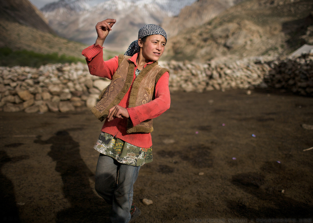A young shepherd snaps calling out her animals. Trekking up and down the Rivak valley, spending time in the high pasture etc. Nearby Khorog.<br /> <br /> The town of Khorog (2200m), is the capital of the Gorno-Badakhshan Autonomous Province (GBAO) in Tajikistan. It is situated in the Pamir Mountains (ancient Mount Imeon) at the confluence of the Gunt and Panj rivers.<br /> The city is bounded to the south and to the north by the deltas of the Shakhdara and Gunt rivers, respectively. The two rivers merge in the eastern part of the city flow through the city, dividing it almost evenly until its delta in the river Panj, also being known as Amu Darya, or in antiquity the Oxus on the border with Afghanistan. Khorog is known for its beautiful poplar trees that dominate the flora of the city.<br /> Khorog is one of the poorest areas of Tajikistan, with the charitable organization Aga Khan Foundation providing almost the only source of cash income. Most of its inhabitants are Ismaili Muslims.<br /> <br /> Tajikistan, a mountainous landlocked country in Central Asia. Afghanistan borders it to the south, Uzbekistan to the west, Kyrgyzstan to the north, and People's Republic of China to the east. Tajikistan also lies adjacent to Pakistan separated by the narrow Wakhan Corridor.<br /> Tajikistan became a republic of the Soviet Union in the 20th century, known as the Tajik Soviet Socialist Republic.<br /> It was the first of the Central Asian republic to gain independence in December 1991.