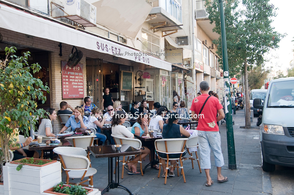 Israel, Tel Aviv, People in an outdoor Cafe in Sheinkin Street