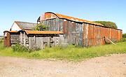 Rusty red barn the Gower peninsula, near Swansea, South Wales, UK