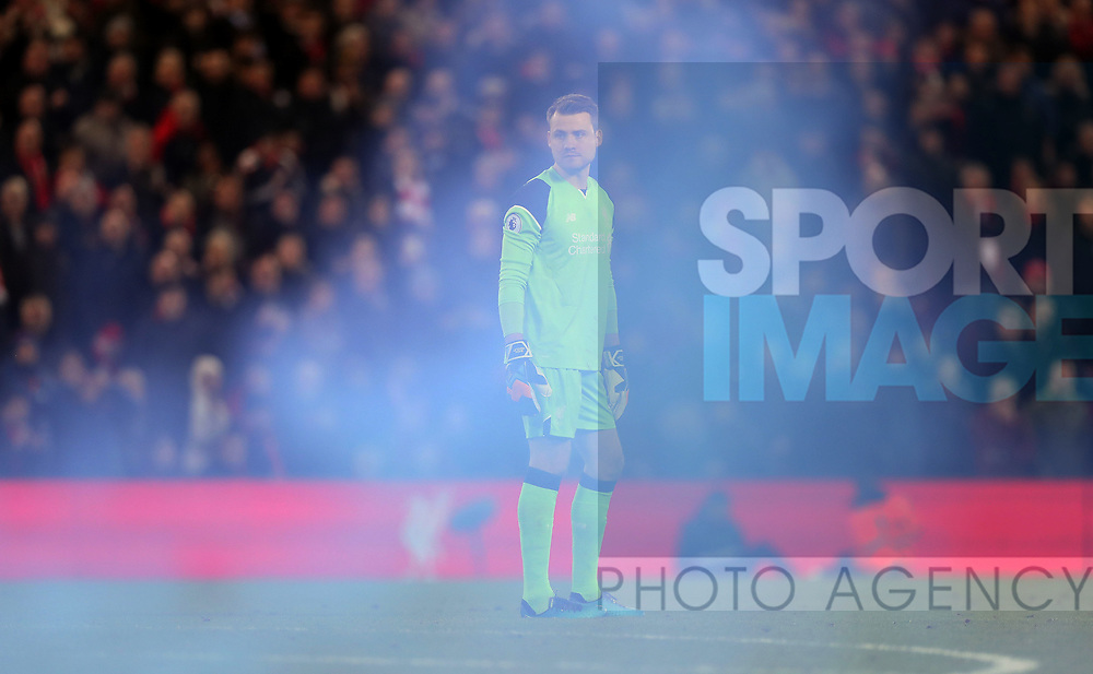Simon Mignolet of Liverpool appears behind smoke from a flare that was thrown during the English Premier League match at Anfield Stadium, Liverpool. Picture date: December 31st, 2016. Photo credit should read: Lynne Cameron/Sportimage