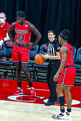 NORMAL, IL - February 27: Amy Bonner gets ready to put the ball back in play by Harouna Sissoko and DJ Horne during a college basketball game between the ISU Redbirds and the Northern Iowa Panthers on February 27 2021 at Redbird Arena in Normal, IL. (Photo by Alan Look)