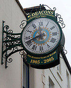Clock outside Deacons Jewellers shop est 1848, Royal Wootton Bassett, Wiltshire, England, UK