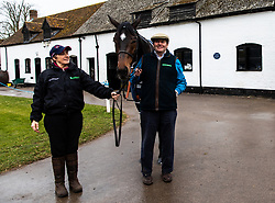 Nicky Henderson and Altior lead out from his stall by stable hand Jane during the visit to Nicky Henderson's yard at Seven Barrows, Lambourn.
