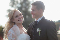 Close-up of a bride and groom smiling, Ammersee, Upper Bavaria, Bavaria, Germany