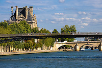 Paris, France. View from a boat on the river Seine. View east with Passerelle Léopold-Sédar-Senghor footbridge, towards Pont Royal and Pavillon de Flore, part of Louvre.