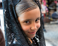 A little girl proud of her laced black mantilla in the streets of Granada.
