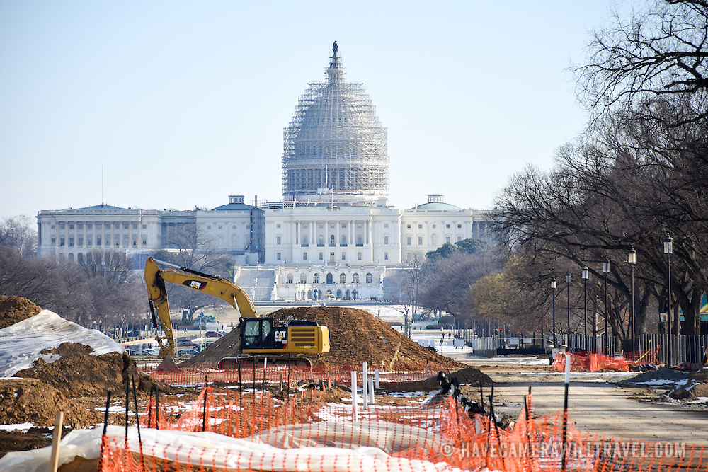 Renovations on a section of the eastern end of the National Mall in Washington DC, with the dome of the U.S. Capitol Building in the background covered in scaffolding as it undergoes its own repairs.
