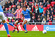 Lewis Morgan of Sunderland (17) and Nathan Thompson of Portsmouth (20) in action during the EFL Sky Bet League 1 first leg Play Off match between Sunderland and Portsmouth at the Stadium Of Light, Sunderland, England on 11 May 2019.